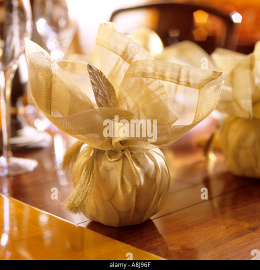 Wrapped table decorations for Christmas table display - Stock Image