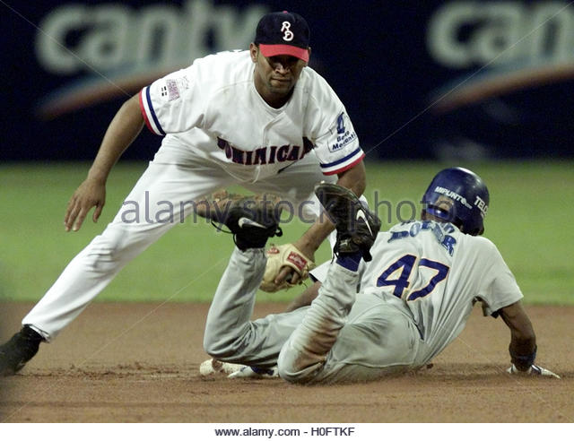 Dominican Republic's Licey Tiger D'Angelo Jimenez tags out Venezuela's  Magallanes Endy Chavez in the - Stock Image