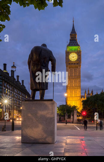 The statue of Winston Churchill and Big Ben at night, Westminster, London - Stock Image