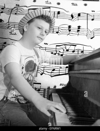 pianist, young pianist, music, musical, piano, portrait, boy, youth, talent, musical notes, keys, black and white, - Stock Image