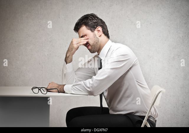 Stressed office worker - Stock Image