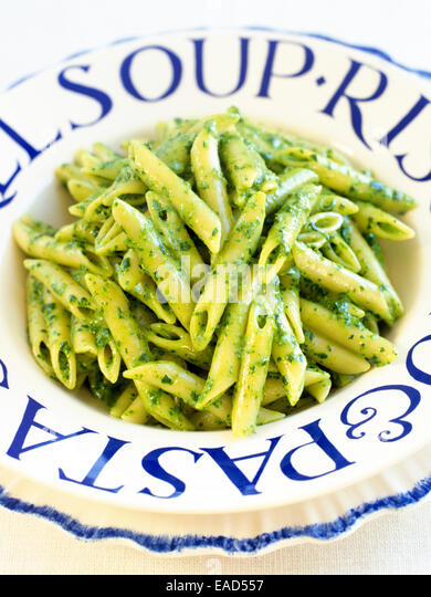 penne with pesto in bowl - Stock Image