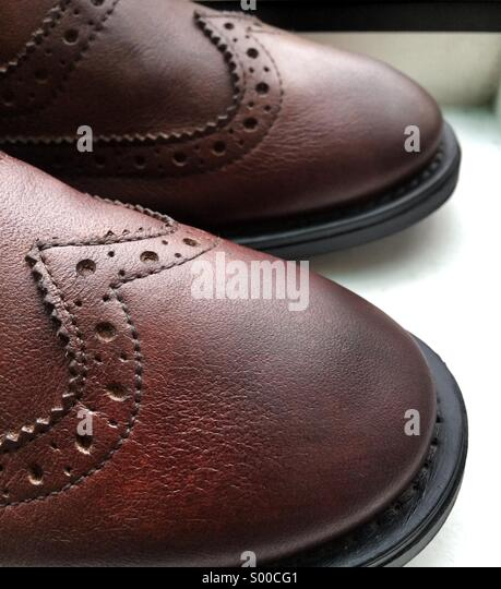 Details on a brown wingtip brogue - Stock Image