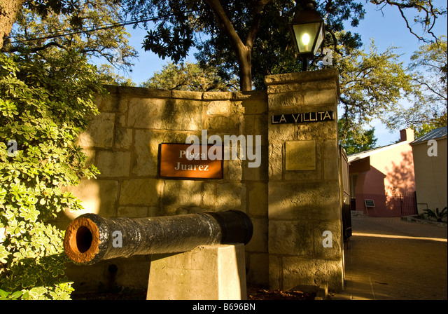 La Villita entrance gate cannon juarez plaza historic arts village san Antonio texas tx tourist attraction shopping - Stock Image