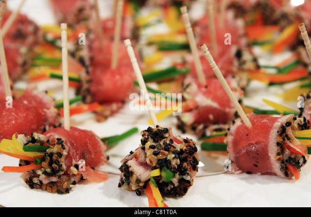 side view of a plate of tuna sushi appetizers - Stock Image