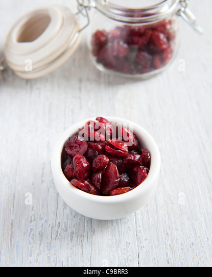 Dried Cranberries In A White Dish - Stock Image