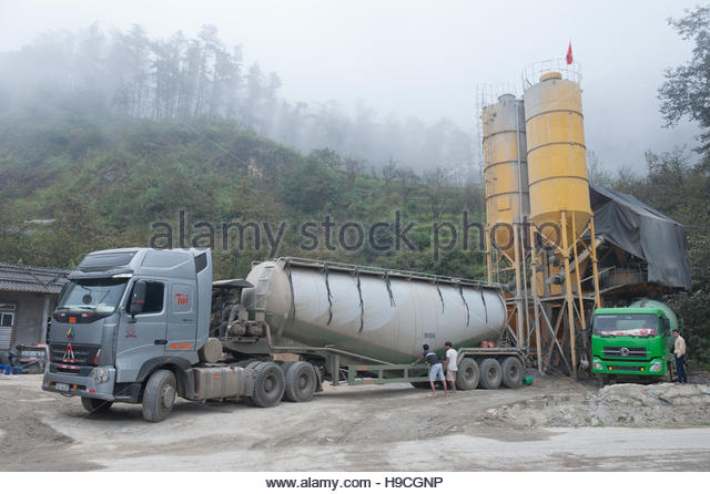 Sapa Vietnam Industry. A freight truck picks up materials from nearby quarries. - Stock Image