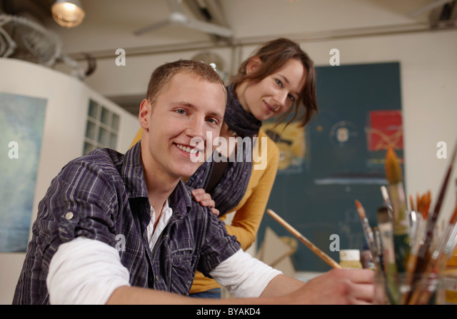 Young artist with girlfriend - Stock Image