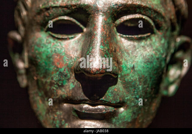 Madrid, Spain - February 24, 2017: Roman head of bronze statue with empty eyes at National Archeological Museum - Stock Image
