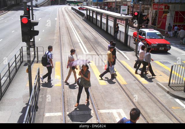 China Hong Kong Island King's Road pedestrians crossing Asian man woman - Stock Image