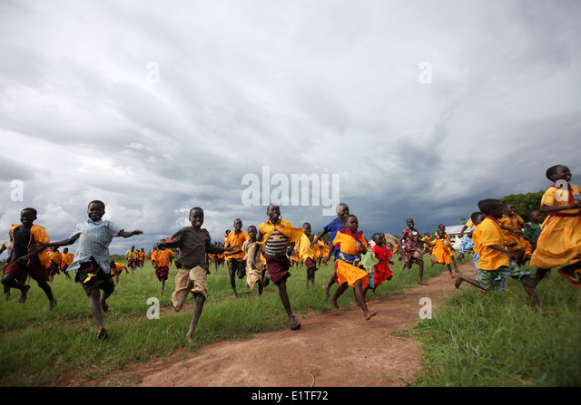 Children running in northern Uganda - Stock Image