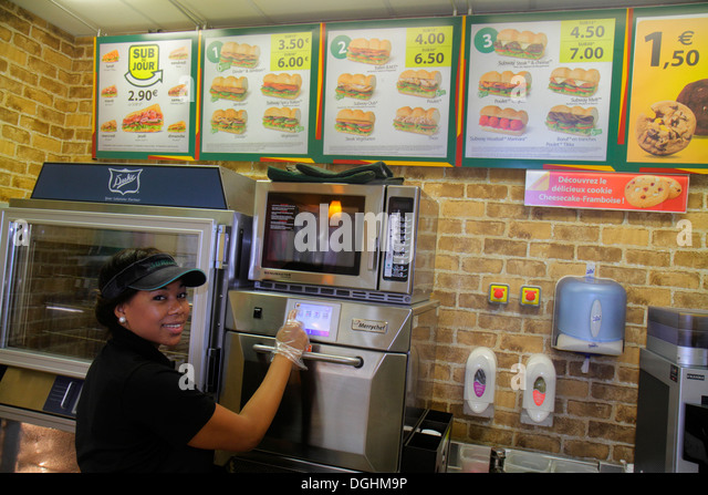 Paris France Europe French 4th arrondissement Subway sandwich shop submarine sandwiches Black woman African immigrant - Stock Image
