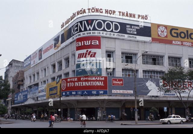 Vietnam Saigon Ho Chi Minh City Nguyen Hue Boulevard businesses billboards advertising - Stock Image