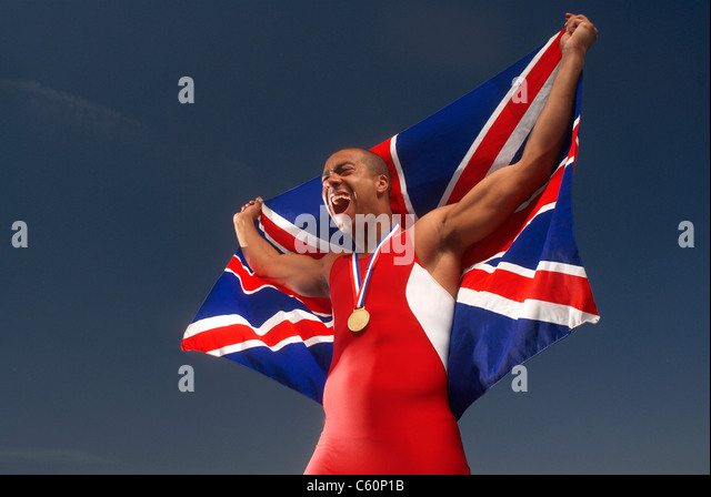 Athlete with medal and British flag - Stock Image