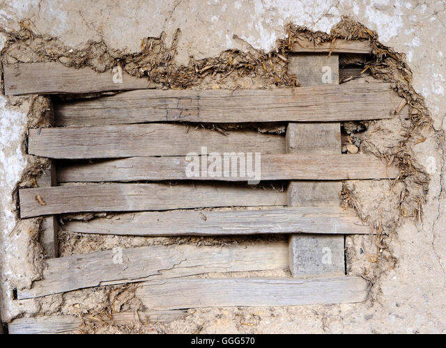 Detail of wattle and daub construction in a Tudor building showing lathes and the texture of the daub and surface - Stock Image