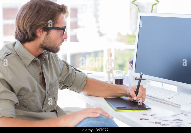 Artist using graphics tablets - Stock Image