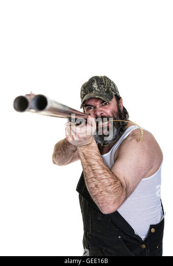 Angry hillbilly aiming a shotgun on a white background. - Stock Image
