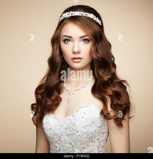 Portrait of beautiful sensual woman with elegant hairstyle. Wedding dress. Fashion photo - Stock Image