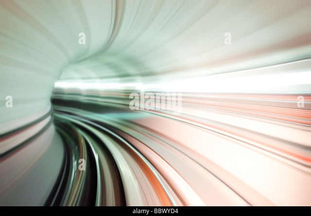 Abstract train tunnel view in high speed. Photo looking in front of a moving train at Kuala Lumpur, Malaysia. - Stock Image