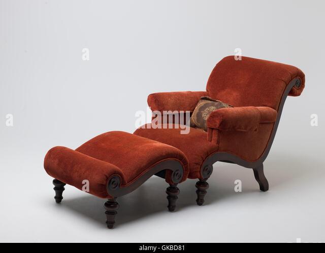 Burnt sienna chair and ottoman set - Stock Image