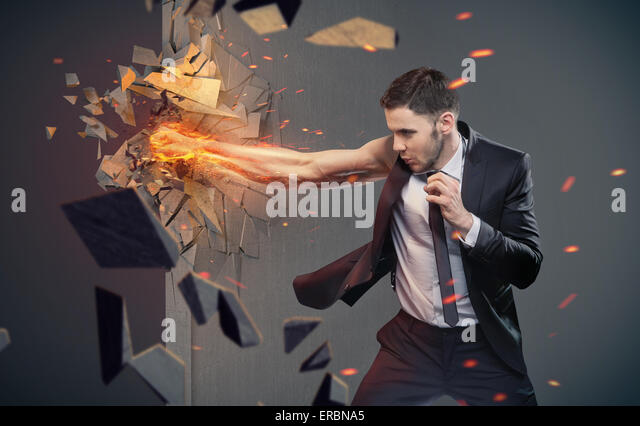 Conceptual portrait of a clever businessman beating a barrier - Stock Image