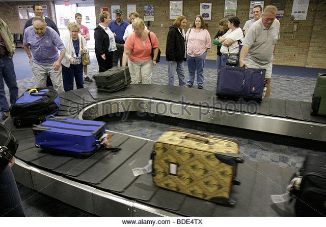 Michigan Saginaw MBS International Airport arrival baggage carousel circular conveyor belt luggage claim area passenger - Stock Image