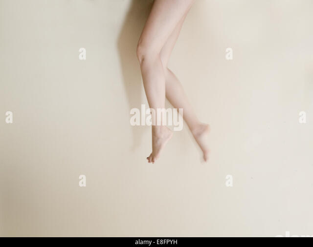 Low section of young woman's legs - Stock Image