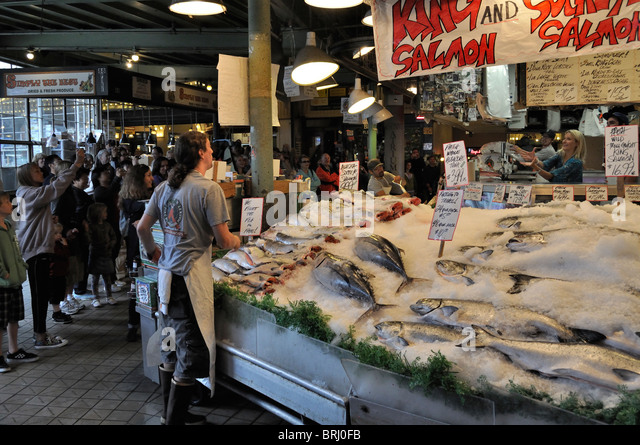 seattle fish market throw stock photos seattle fish