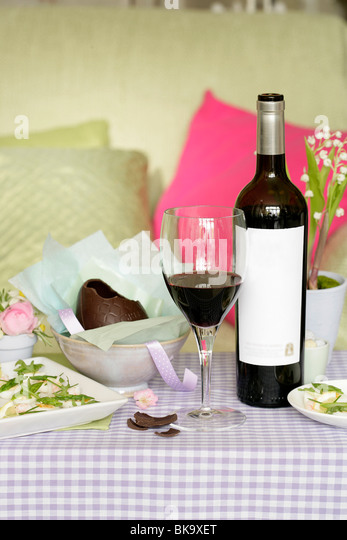 easter wine and chocolate egg - Stock Image