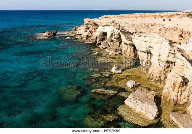 Sea Caves along Rocky Coastline by Mediterranean Sea, Cape Greco, National Forest Park, Ayia Napa, Cyprus - Stock-Bilder