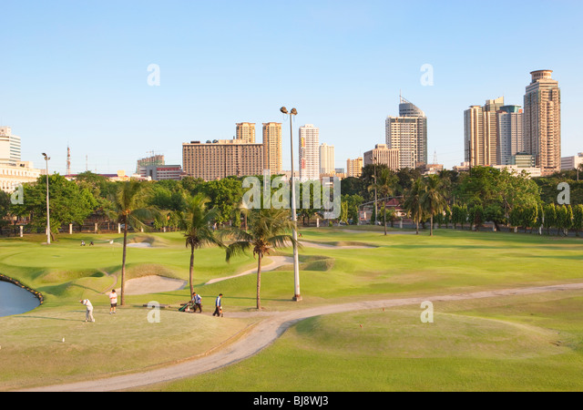 Intramuros golf club with Manila in background; Intramuros; Manila; Philippines - Stock Image