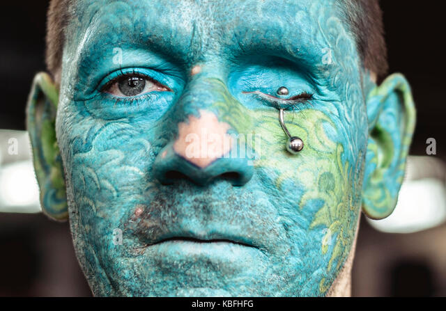 Barcelona, Spain. 30 September, 2017:  A tattoo enthusiast shows his full-face tattoo and eye piercing at the 20th - Stock Image