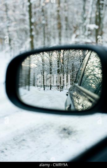 Closeup on rear-view mirror - Stock Image