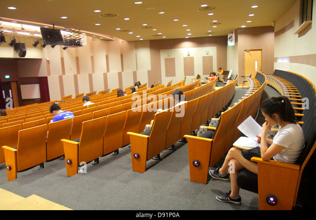 Singapore National University of Singapore NUS University Town school student campus lecture hall auditorium seats - Stock Image
