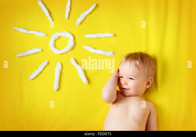 little boy with sunglasses and sun shape - Stock Image