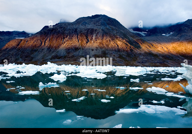 Sunset and reflections, Sermilik Fjord, East Greenland - Stock Image