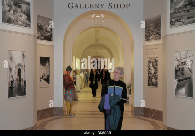 Washington DC National Gallery of Art West Building museum hallway gift shop expansion photos woman man couple arches - Stock Image