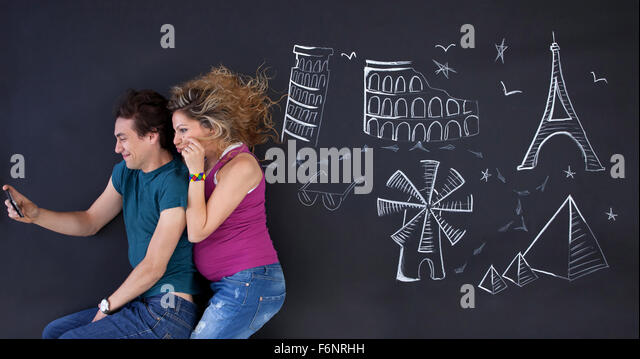 Young couple making a selfie with world attractions ilustrations behind. - Stock-Bilder