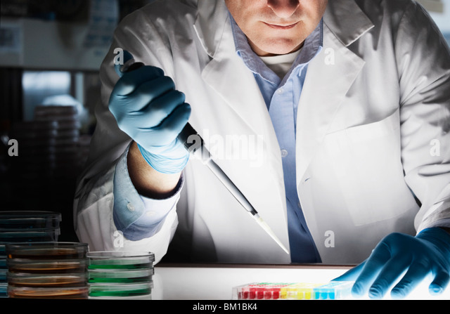 Doctor researching in a laboratory - Stock Image