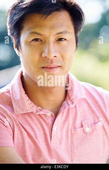 Portrait Of Asian Man In Countryside - Stock Image