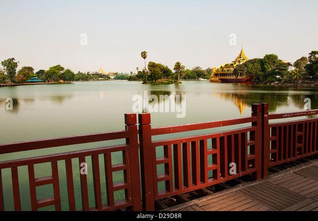 A beautiful view of Shwedagon Pagoda and Royal Barge at Royal Lake, Yangon - Stock-Bilder
