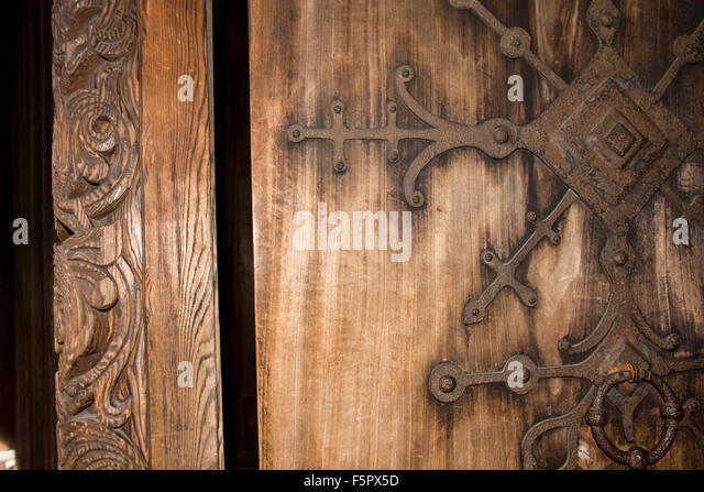 Norway, Oslo, Norsk Folk Museum (aka Norsk Folkemuseum). Historic wooden Stave Church from Gol, c.1200. Wooden door - Stock Image