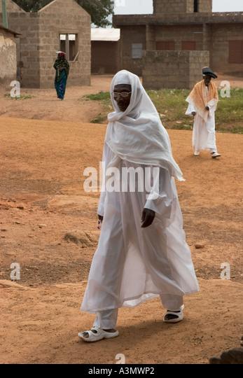 Villager going to Friday Prayers at Larabanga Mosque, Larabanga, Northern Ghana, West Africa. - Stock Image