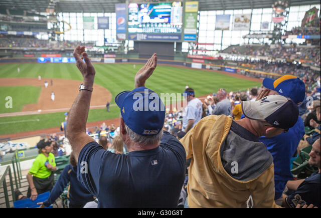 Fans at Miller Park in Milwaukee, Wisconsin enjoy a Milwaukee Brewer's baseball game. - Stock Image