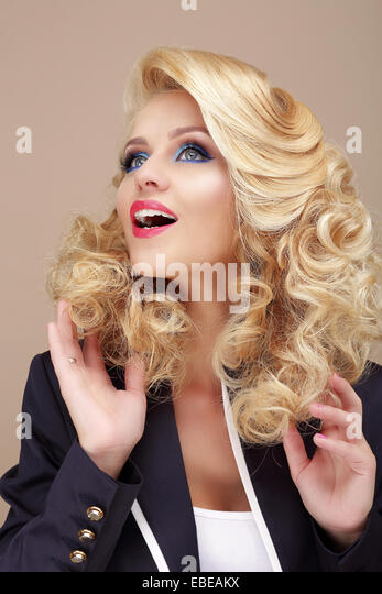 Astonishment. Surprised Blond Woman Looking Up - Stock Image