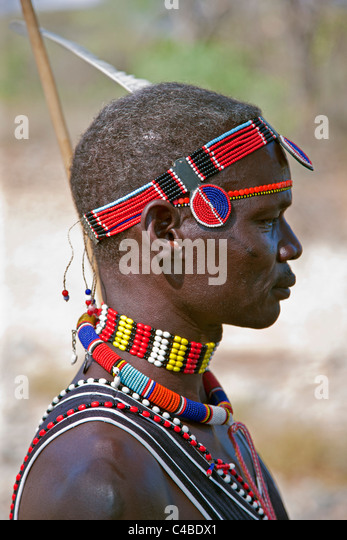 A Pokot man wearing typical beaded ornaments of his tribe. The Pokot are pastoralists speaking a Southern Nilotic - Stock Image
