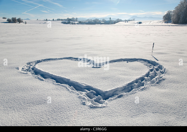 Heart shape in pristine snow - Stock Image
