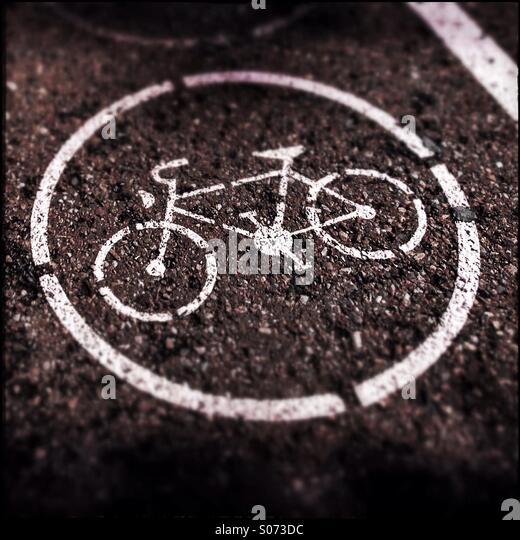 Bicycle sign painted on the asphalt - Stock Image
