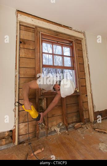 Saw Cutting Through Wall : Reciprocating saw stock photos