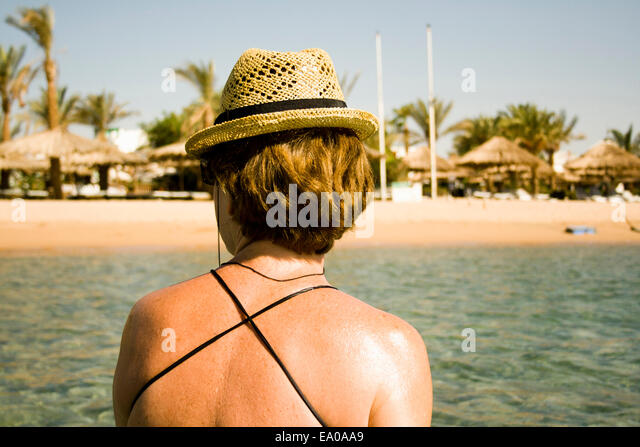 Woman sunning by seaside, Sharm El Sheikh, Egypt - Stock Image